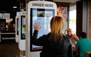 Ordering, and customising a burger at MacDonalds using touchscreen digital signage