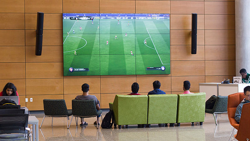Large gaming screen digital signage in schools